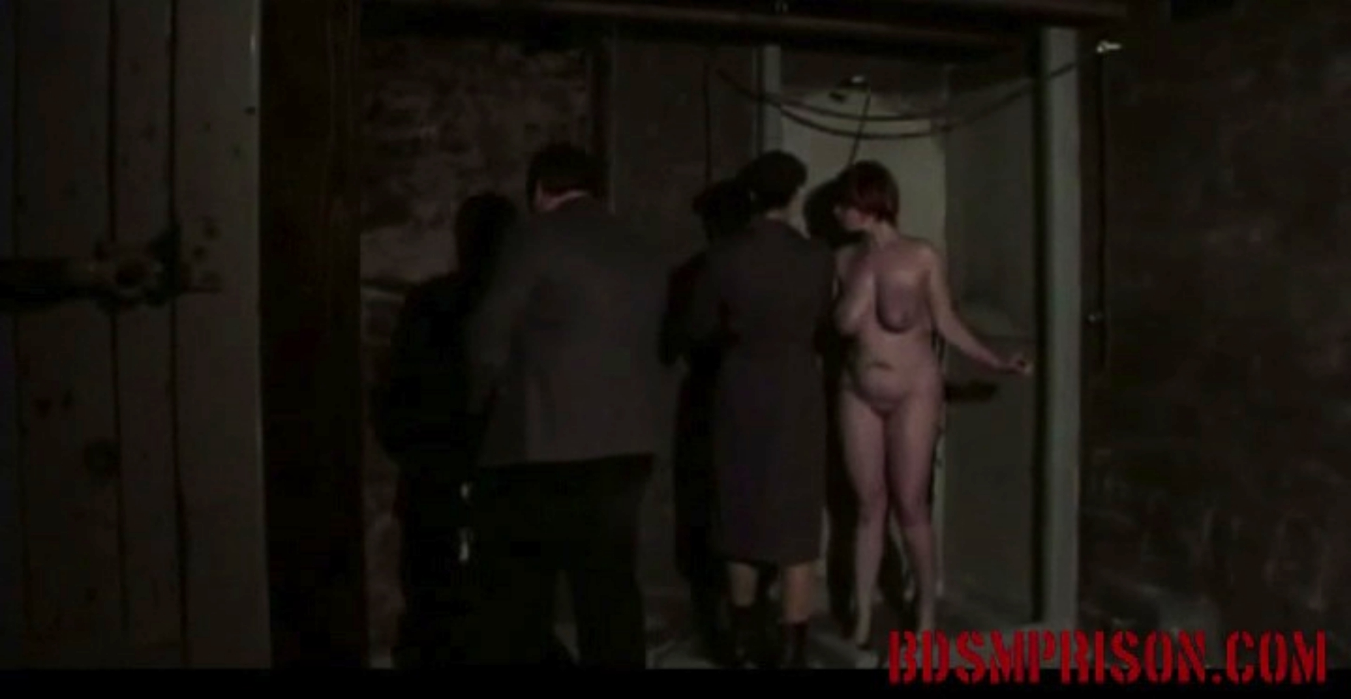 Lori endures domination bondage rough scrub down. Lori was arrested for adultery and imprisoned. Her punishment will be harsh in order to educate her to be a decent woman. A couple prison guards will take on the task of her sex slave training. She has to be washed first.