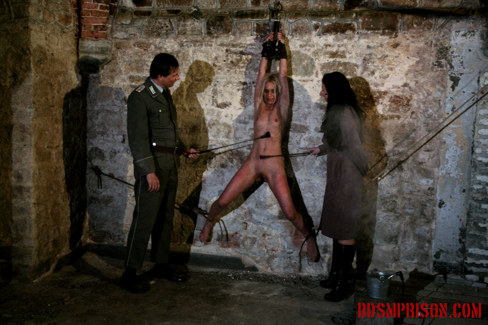 Domination bondage electro play with mirela. Mirela was arrested for being a spy and imprisoned. Her punishment will be harsh, worse than her interrogation. A couple prison guards will take on the task of her sex slave training. She has to be washed first. She must endure a BDSM Prison mistress and Master, domination, humiliation, fingering, spanking, smacking, whipping, bondage, breast, pussy and nipple molest with a rough scrub down, suspended upside down. She better get used to it. That's how all prisoners are washed in this prison.