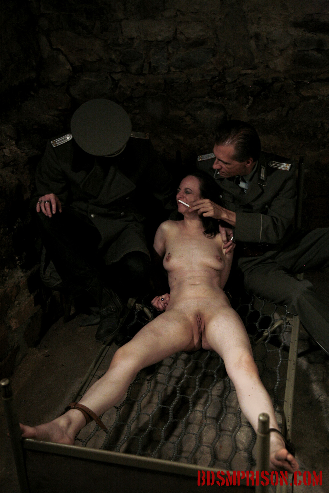 Nadja endures domination bondage nipple tormented with cigarettes. Nadja, a crazy young slut, mimes innocent when she wakes up bound to a bed frame in the basement of our institute. She's been charged with prostitution and has earned sex slave traininig. A prison guard welcomes Nadja to her a punishment consisting of two BDSM Prison Masters, domination, humiliation, fingering, spanking, smacking, whipping, bondage, breast, cunt and nipple anguished with cigarettes and a lighter. She pleads for mercy, swearing she's innocent. Obviously her Master does not agree.