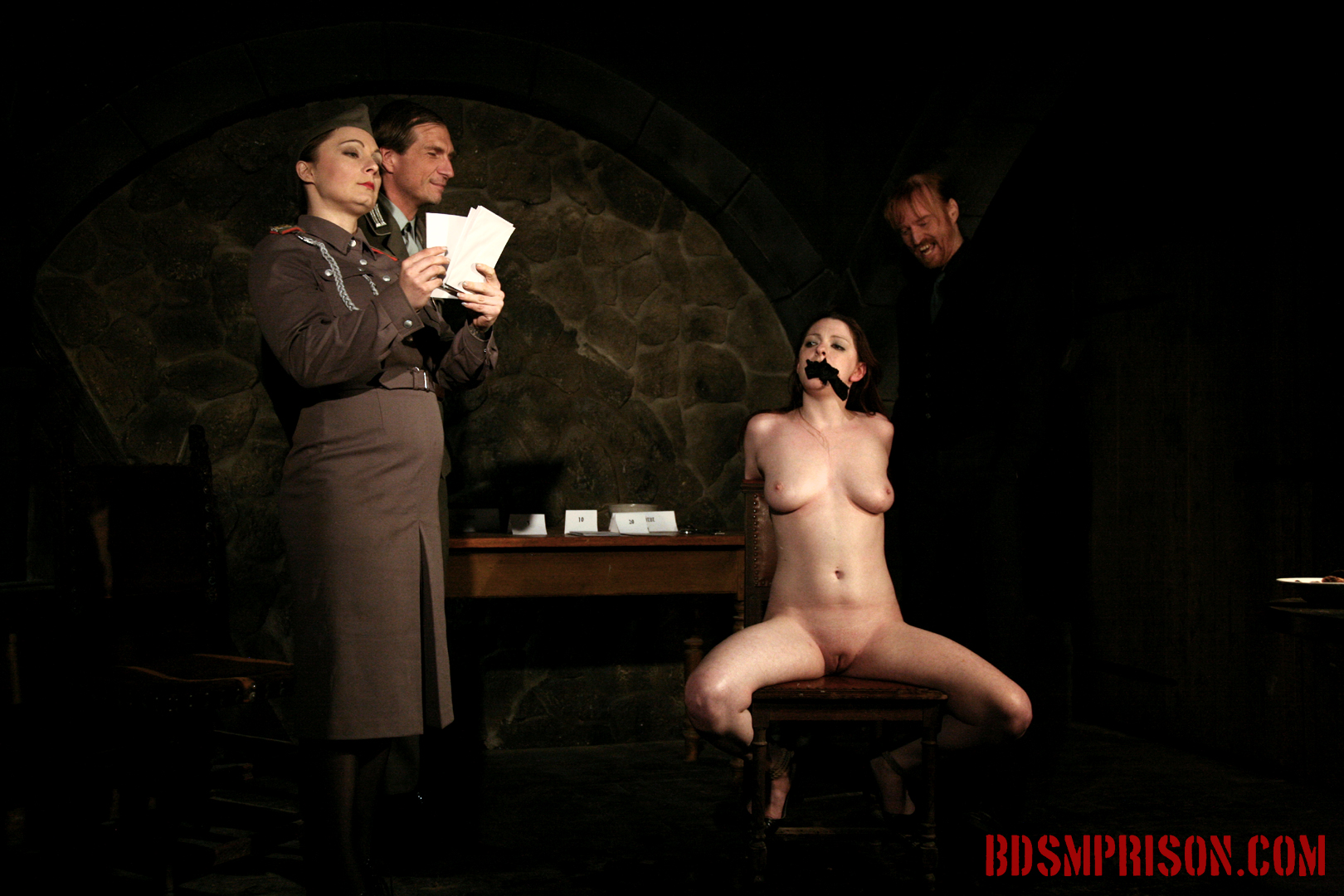 Sophie endures domination bondage cunt and nipple tormented. Sophie is a betting loser and has amounted quite a debt. So Sophie is imprisoned in the Institute for punishment. Two prison guards and BDSM Major Marcowicz joins the night for her pleasure. Sophie will endure domination, bondage, breast, pussy and nipple torture with clamps, intense spanking, whipping and smacking on her thighs, tits and face, humiliation, sex toys, nipple weights. She has to smile the entire time, every slap.