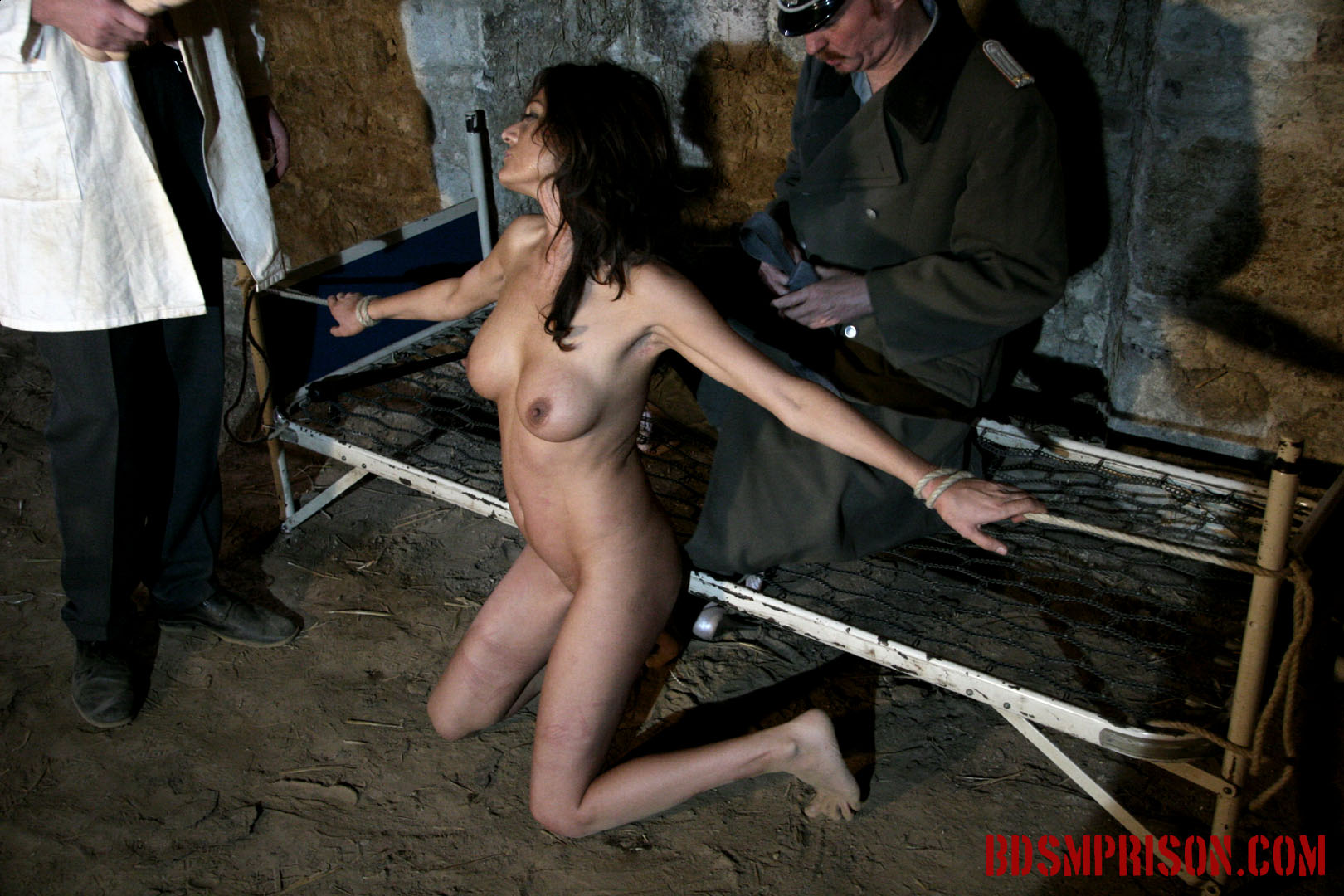 Natalia endures domination rope bondage dildo deepthroat bj. Natalia is castigate daily by a prison doctor and guard. She's been sentenced to lifelong sex slave traininig. Today she is bound to a bed frame. She must endure two BDSM Prison Masters, domination, humiliation, fingering, spanking, smacking, whipping with a leather belt, rope bondage, breast, cunt and nipple torment. Next, one of the guards wants to see her give a sloppy deepthroat blowjob, penetrating her throat violent and fast with a dildo, making her gag up spit all over her tits.