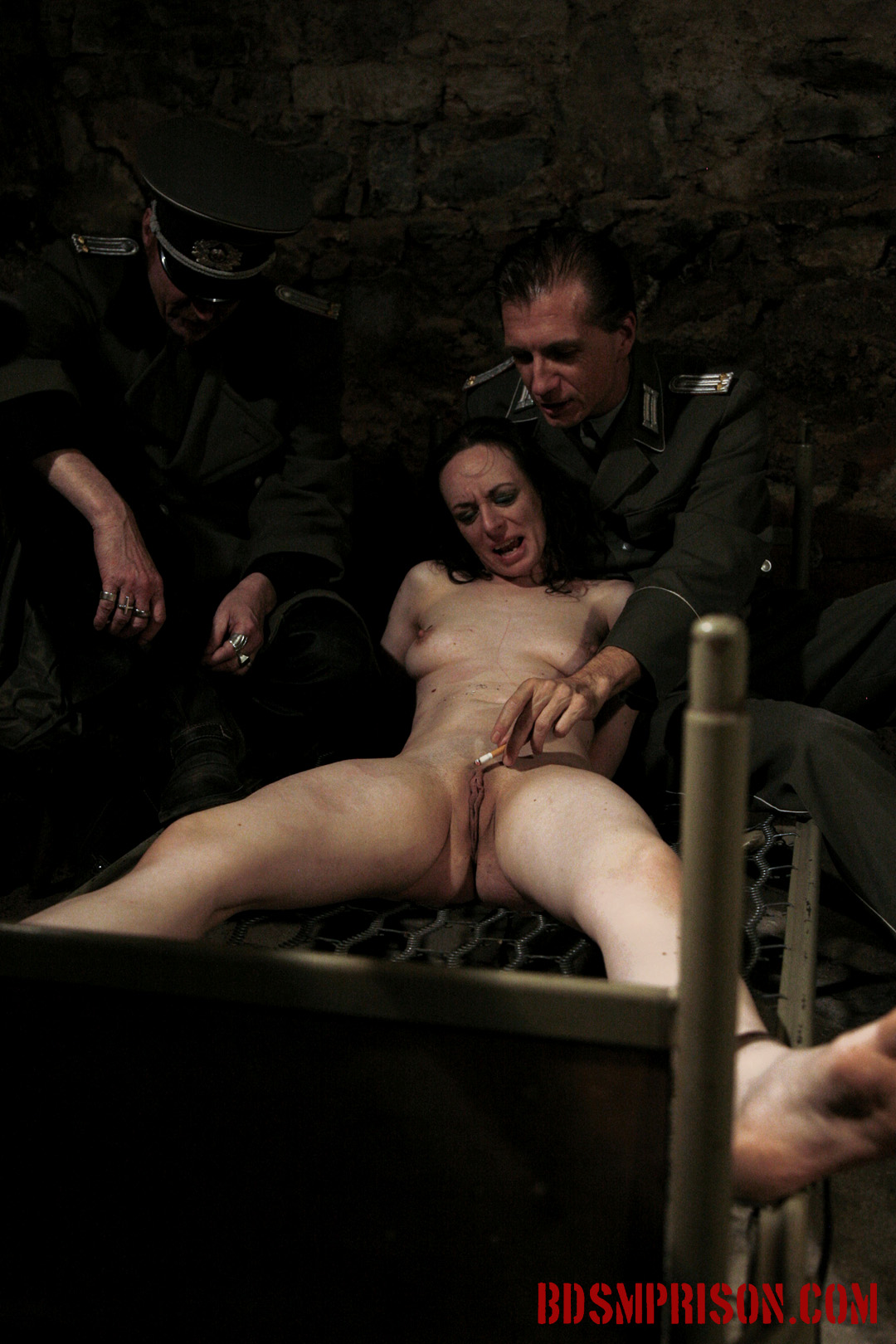 Nadja endures bondage nipple torment with cigarettes. Nadja, a crazy young slut, mimes innocent when she wakes up bound to a bed frame in the basement of our institute. She's been charged with prostitution and has earned sex slave traininig. A prison guard welcomes Nadja to her a punishment consisting of two BDSM Prison Masters, domination, humiliation, fingering, spanking, smacking, whipping, bondage, breast, vagina and nipple tortured with cigarettes and a lighter. She pleads for mercy, swearing she's innocent. Obviously her Master does not agree.