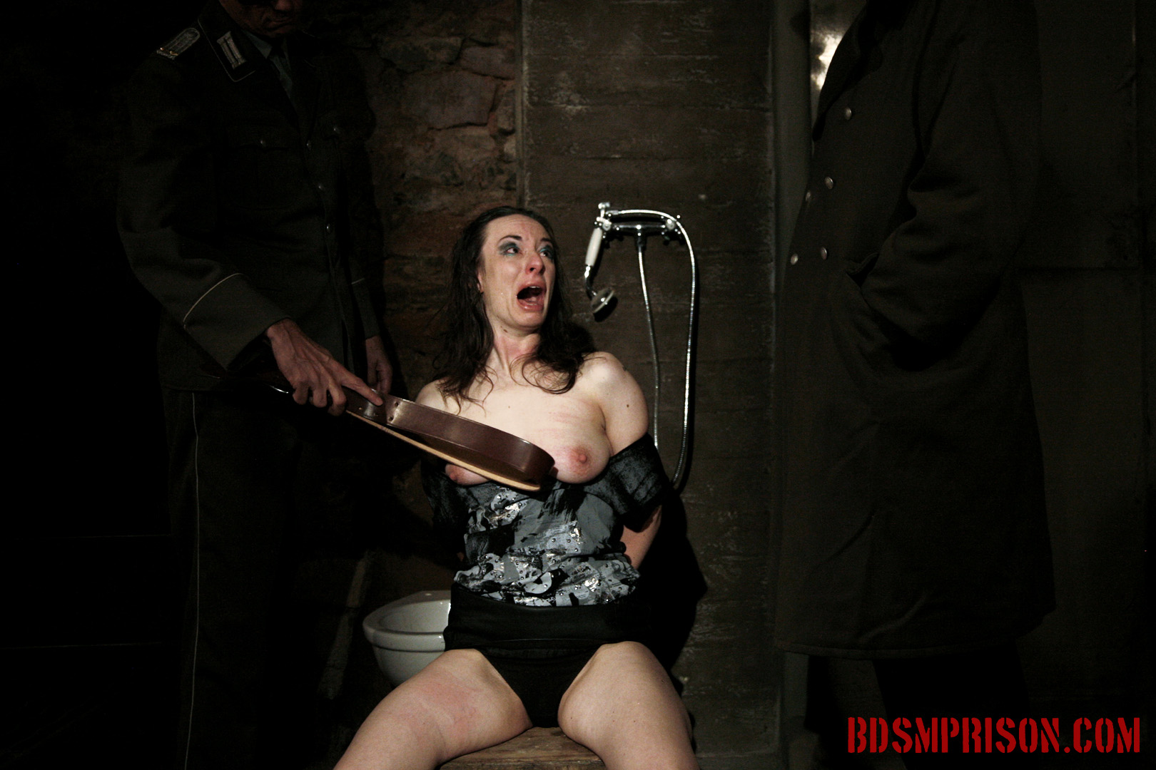 Nadja endures bondage leather belt. Nadja must endure two BDSM Prison Masters, domination, humiliation, fingering, spanking, smacking, whipping, bondage, breast, cunt and nipple molested with a leather belt. She pleads for mercy, crying from all the pain. Obviously her Masters don't care and continue with her sentence.