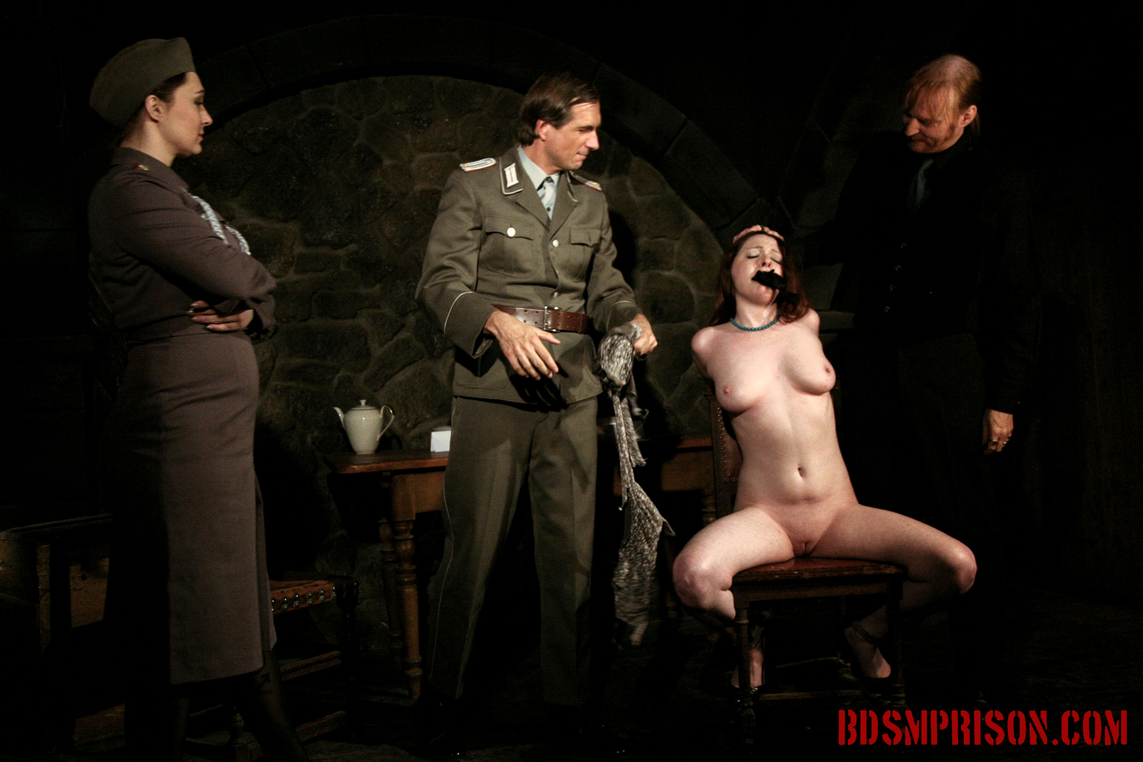 Sophie domination bondage degradation sex toys. Sophie will endure domination, bondage, breast, cunt and nipple torment, spanking, whipping and smacking, humiliation, sex toys here at BDSM prison. They even pour hot coffee over her breasts. Since her dress is wet, they rip it off!