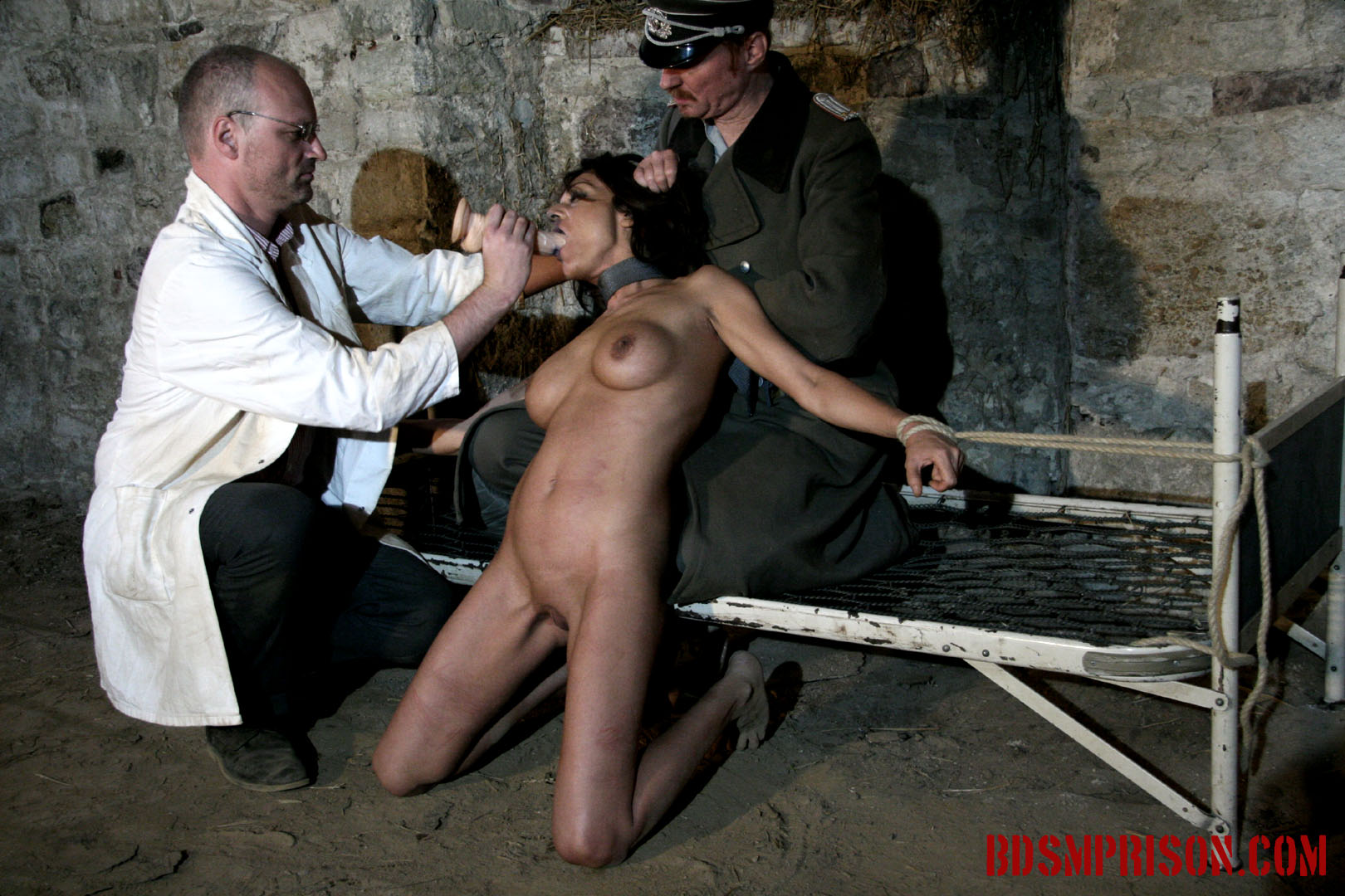 Natalia rope bondage dildo deepthroat bj. Natalia is punish daily by a prison doctor and guard. She's been sentenced to lifelong sex slave traininig. Today she is bound to a bed frame. She must endure two BDSM Prison Masters, domination, humiliation, fingering, spanking, smacking, whipping with a leather belt, rope bondage, breast, kitty and nipple torment. Next, one of the guards wants to see her give a sloppy deepthroat blowjob, penetrating her throat rough and fast with a dildo, making her gag up spit all over her tits.